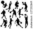 vector basketball players in silhouettes - stock photo