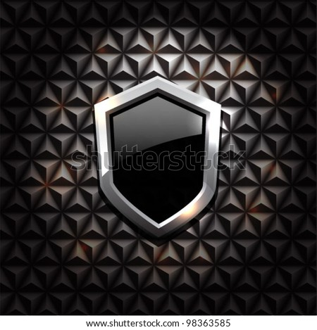 Vector black glossy metal shield on black vintage background - stock vector