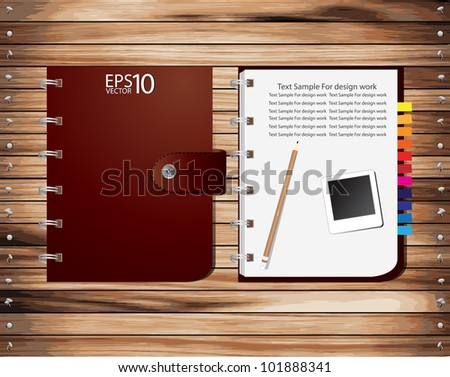 Vector Brown Notebook on wood plank - stock vector