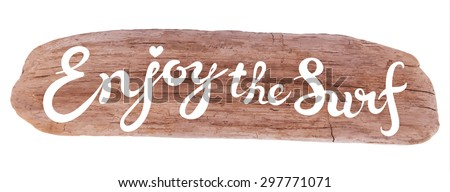 Vector calligraphic inscription on drifted wood background - ENJOY THE SURF poster or greeting card - exclusive hand written vector lettering collection - stock vector