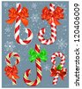 Vector candy canes with bows. - stock vector