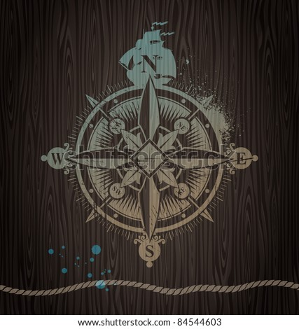 Vector compass painting on a wooden wall - stock vector