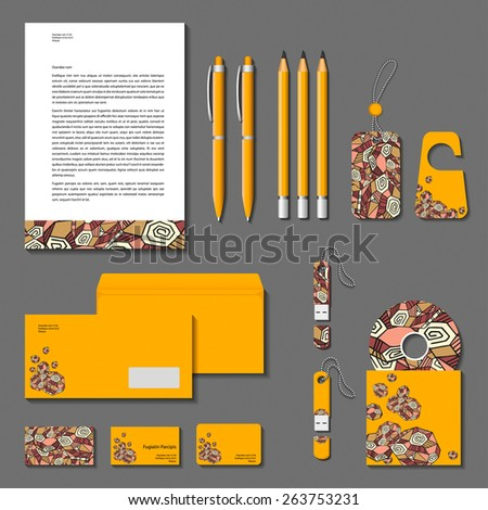 Vector corporate identity yellow polygonal design. Cards, letter, envelope, business cards, pencils, pens, tags, flash memory.  - stock vector