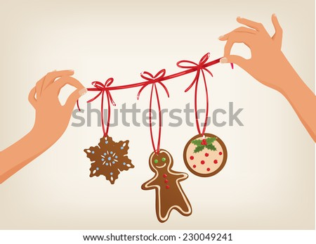 Vector cute hands holding a Christmas garland with gingerbread cookies - stock vector