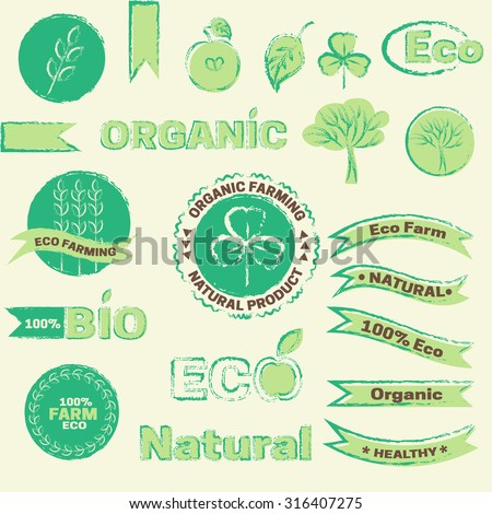 Vector design elements. Natural product sign and logo. Organic farming, eco friendly technology and produce, green design. Sketch ribbons, apple, tree, leaf, clover.