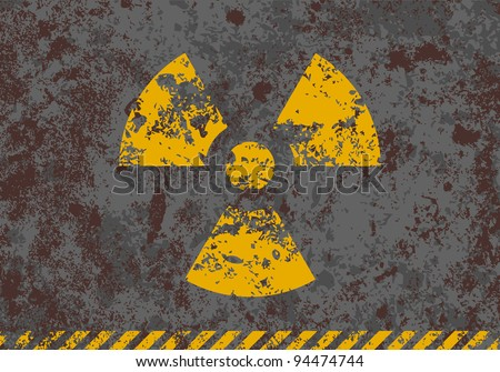Vector grunge illustration of radiation sign on textured background - stock vector