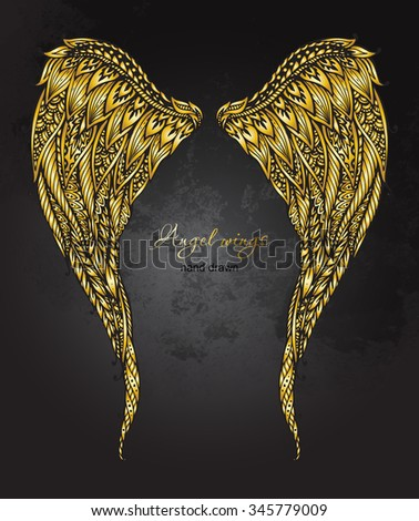 Vector hand drawn ornate golden angel wings in zentangle style. Doodle  illustration on grunge background  - stock vector
