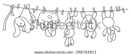 Vector hanging  rabbits cartoons on clothing line with pegs. - stock vector
