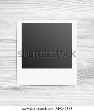 Vector illustration of blank photo frames on white wood background - stock vector