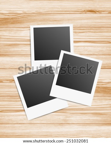Vector illustration of 3 blanks photo frames on wood background