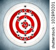 vector illustration of dollar mark with bullet hole on target board - stock photo