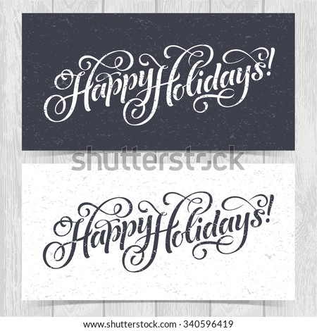 Vector illustration of paper cards with Happy Holidays lettering and ornamental elements. Christmas calligraphy on wood background. - stock vector