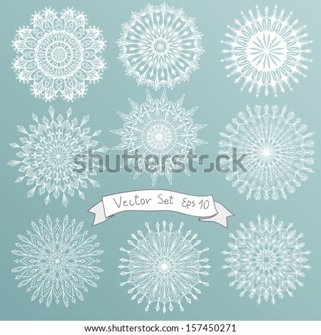 Vector illustration set with snowflakes.  Hand drawn icon set. - stock vector