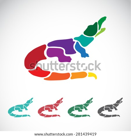 Vector image of an crocodile design on white background - stock vector