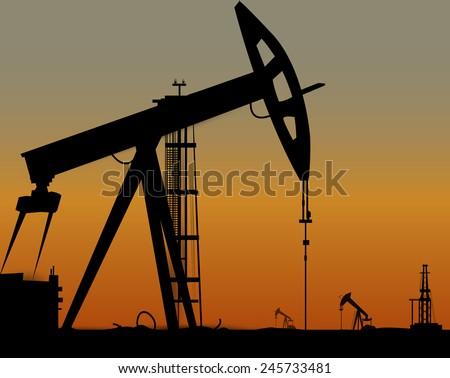 Vector image of oil derricks on the ground. Vector eps 10 - stock vector