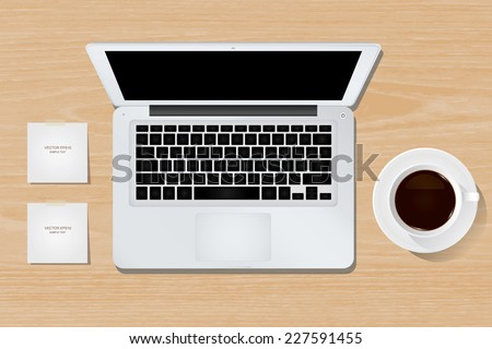 Vector laptop computer and cup of coffee on wooden background. - stock vector