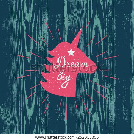 "Vector motivation card with unicorn silhouette, sunbursts, and text ""Dream big"" on the wooden texture. Stylish vintage background with inspirational words. - stock vector"