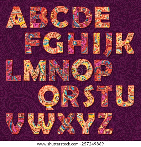 Vector multicolored decorative alphabet with paisley ornament - stock vector