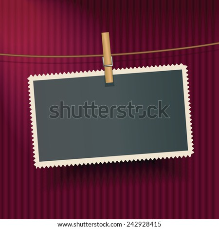 Vector photo frame hanging on the red curtain - stock vector