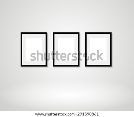 Vector picture frames on wall - stock vector