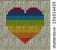 Vector seamless background with rainbow knitted heart  - stock vector