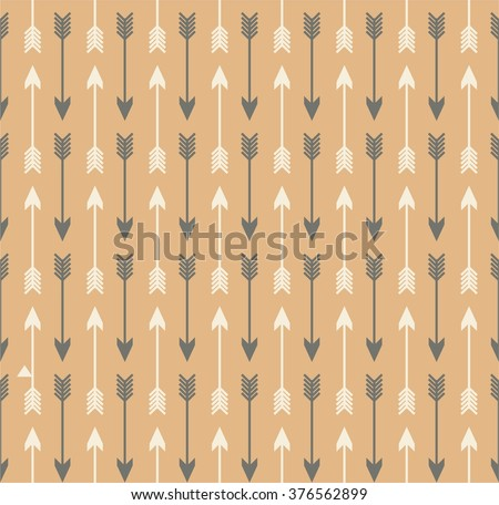 Vector seamless colorful ethnic pattern with arrows. Seamless pattern in native american style.Tribal arrows on brown kraft background - stock vector