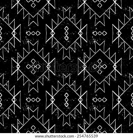 Vector seamless ethnic pattern with american indian motifs in black and white colors. Aztec background. Textile print with navajo tribal ornament. Native american art. - stock vector