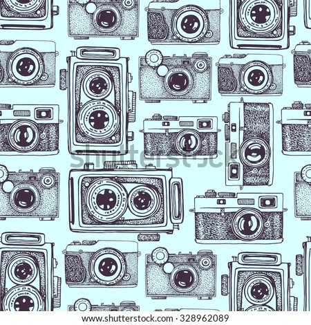 Vector seamless pattern with hand drawn vintage cameras. Beautiful design elements.