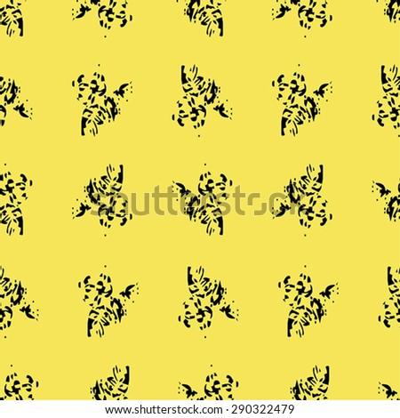 Vector seamless texture with black abstract elements on yellow background