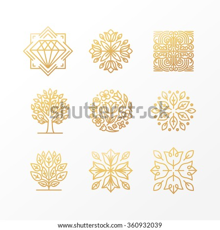 Vector set of abstract golden signs, symbols and logo design templates - luxury concepts and floral emblems in trendy linear style