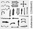 vector set of artistic hand drawn arrows - stock vector