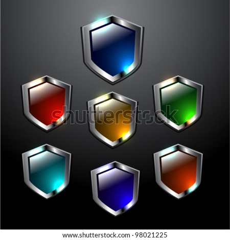 Vector set of glossy vector shields in different colors - stock vector