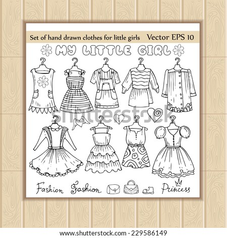 Vector set of hand drawn clothes for little girls. Sketches of clothes for use in design - stock vector