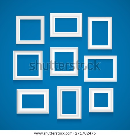 Vector set of white picture frames on blue wall. - stock vector