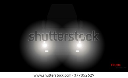 Vector silhouette of truck with headlights on black background. - stock vector