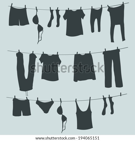 Vector Silhouettes of Laundry on a Rope - stock vector
