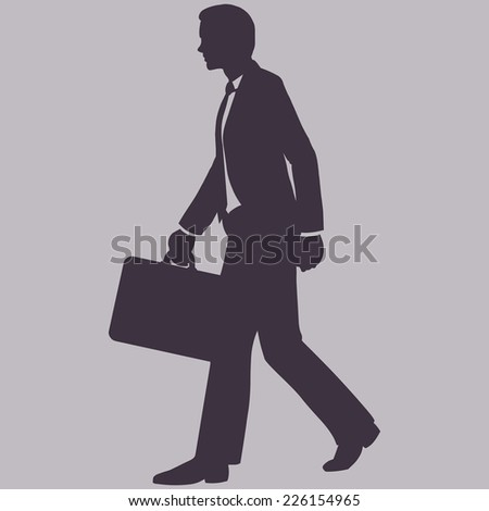 Vector Single Silhouette of Business Man. Man with Briefcase is Walking. Side View. - stock vector