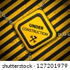 Vector Under construction sign with chains on striped background - stock photo