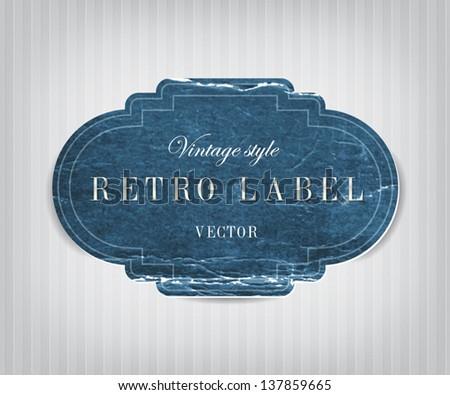 Vector vintage blue distressed crumpled cardboard label - stock vector