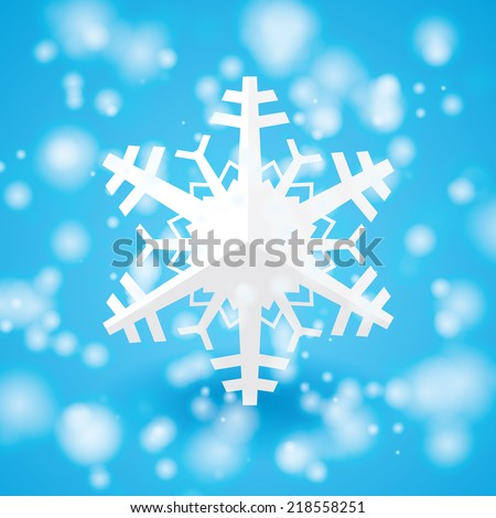 Vector white paper christmas snowflake on a light blue background  - stock vector