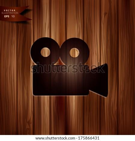 Video camera icon. Cinema symbol. Wooden texture. - stock vector