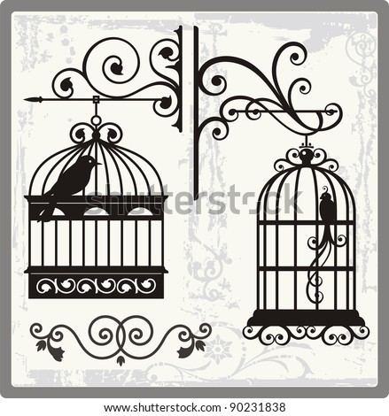 Vintage bird cages with ornamental decorations.