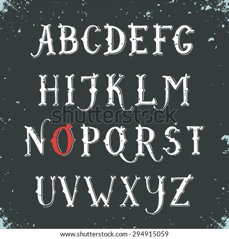 Vintage hand drawn decorative serif alphabet on blackboard