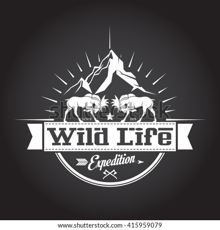 Vintage icon wildlife with moose and mountains in the background. - stock vector