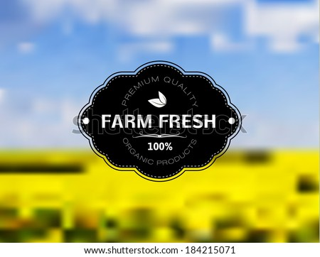 Vintage organic farm stamp on landscape background. Yellow blossoming rape. - stock vector
