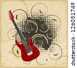 Vintage paper background with the image of an electric guitar - stock
