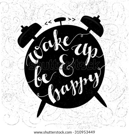 Wake up and be happy. Positive inspirational quote handwritten with modern calligraphy style at black alarm clock shape. Typography vector art for cards, posters and social media content. - stock vector