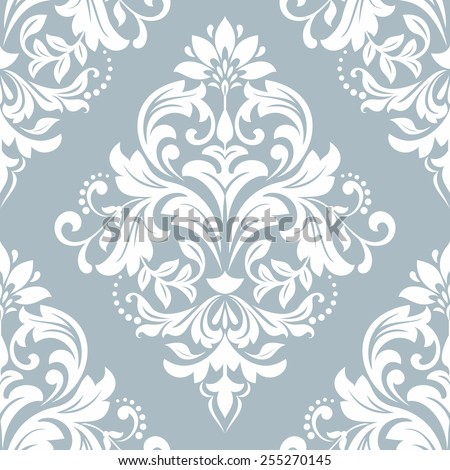 Wallpaper in the style of Baroque. A seamless vector background. Damask floral pattern. White ornament on a blue background. - stock vector