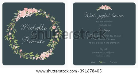 Wedding card invitation with a wreath of delicate pink flowers and a dark background.