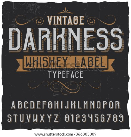 Whiskey label font and sample label design with decoration and ribbon Vintage font Whiskey font Fine label font Handcrafted font Decoration font Font style Retro font Old font Stylized font - stock vector